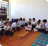 Children in Laos reading donated books