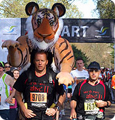 Paul running in last year's London Marathon with the tiger