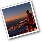 Climber on the summit of Kilimanjaro